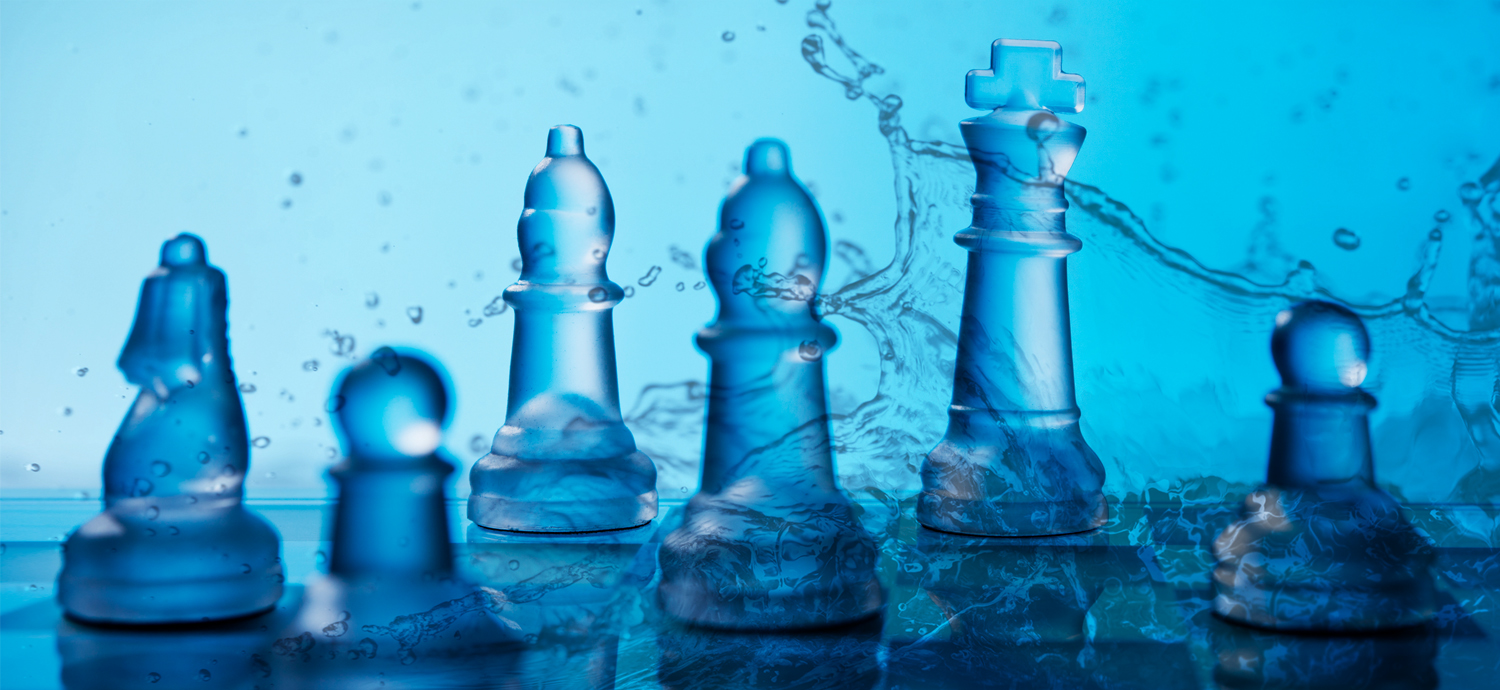 Chess pieces on watery background