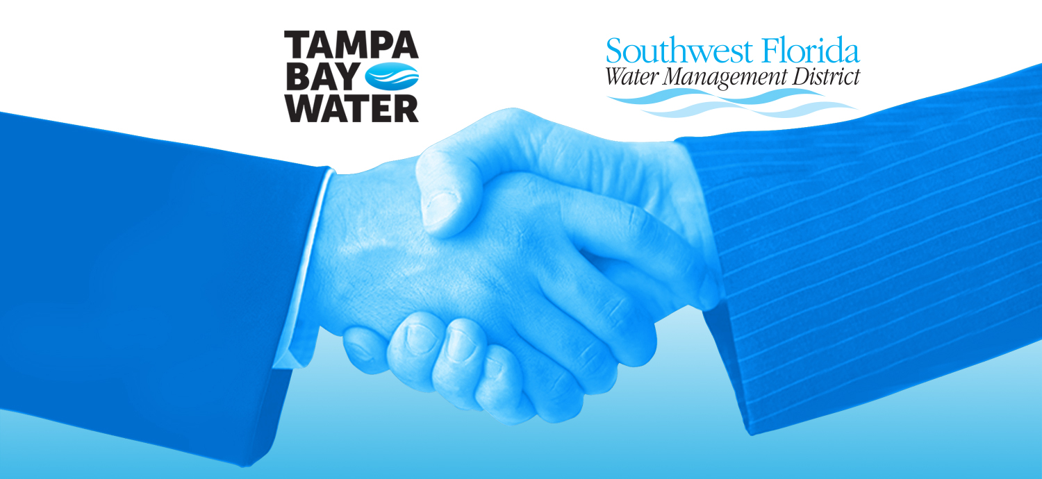 Business men shaking hands with Tampa Bay Water and SWFWMD logos