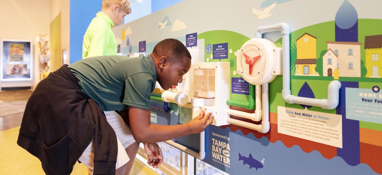 Children at Tampa Bay Water's exhibit at Glazer Children's Museum