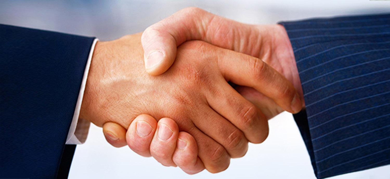 Closeup of handshake between business men