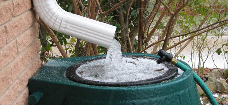 Rain from gutter going into rain barrel