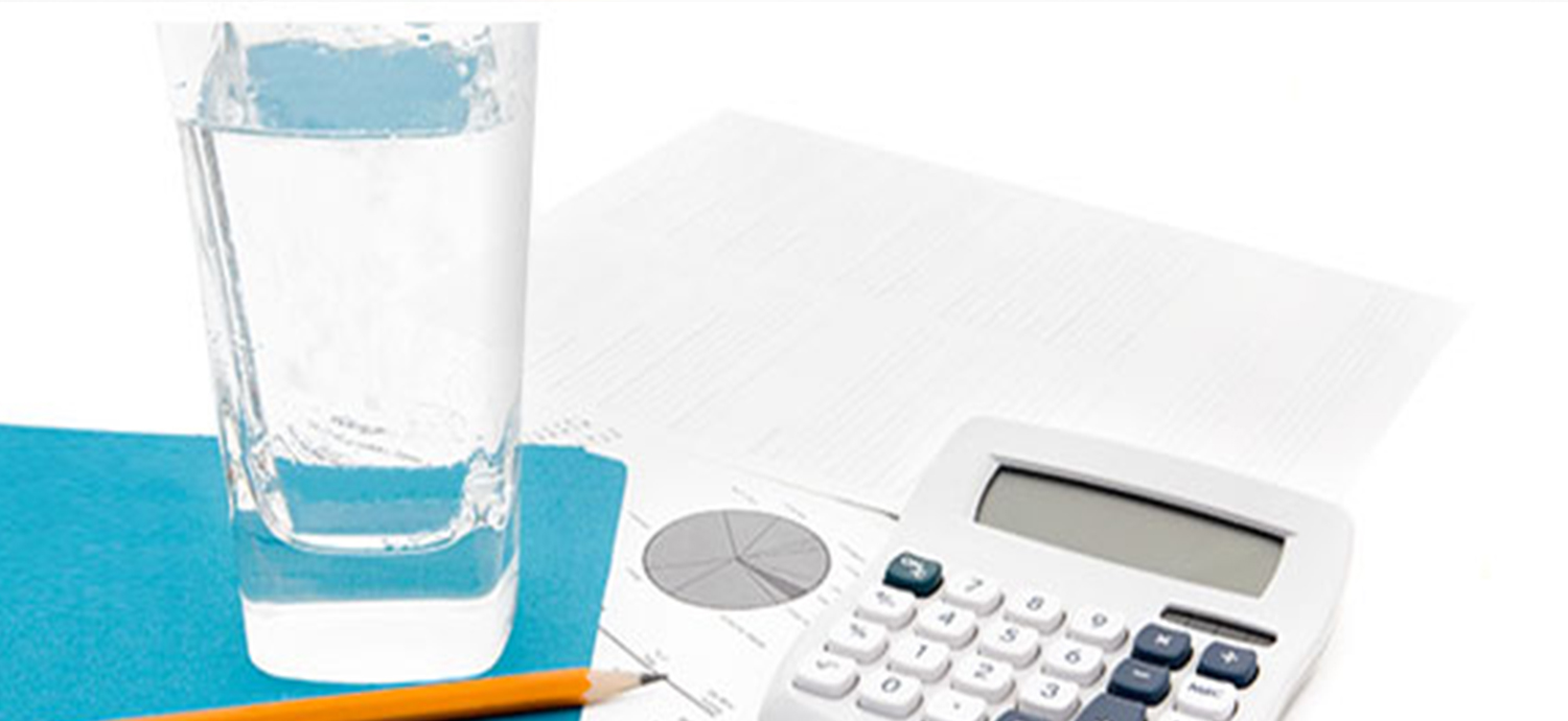 Glass of water and financial equipment